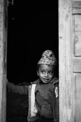Curious boy (vankerkoven.ludovic) Tags: boy kid nepal black white smile curious village mountain street portrait noir et blanc outside