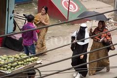 H504_3506 (bandashing) Tags: wires fruit stall umbrella hijab burkah niqab covered street sylhet manchester england bangladesh bandashing aoa socialdocumentary akhtarowaisahmed