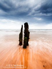 Totems (ScudMonkey) Tags: totems c2016paulbradley coast sea beach sand water tide wash cloud storm groyne wood post landscape seascape colour orange grey slowshutter canon 6d ef1740mmf4l
