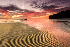Evening tranquility (Luke KC) Tags: queensland sunset dunwich sand ripple texture twilight colour serenity tranquility catamaran shallows beach clouds australia stranded