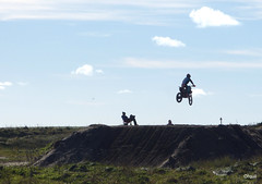 Motor Cycle Scrambling At Burray In Orkney (orquil) Tags: motorcycle motorbike scrambling motorcross club norton burray island airborne aerial competitor motorcyclist contestant seated marshall photographer silhouette steep flattop tabletop course feature earth obstacle rough ground sunny october autumn afternoon sunshine blue sky puffy clouds southisles orkney islands scotland uk unitedkingdom greatbritain orcades interesting eyecatching memorable lucky