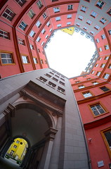 Yellow (The Green Album) Tags: berlin apartment brightly painted paint walls red yellow grey urban architecture courtyard fuji xt1 samyang fisheye persepctive