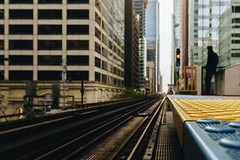 Waiting (Migltellez) Tags: city exploring urban pensive creative a6000 sony perspective cloudy horizon distance person saturday loop downtown chicago elevatedtrain tracks train