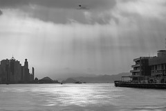 Hong Hong, Victoria harbour (viroj_sup) Tags: landscape hongkong hong kong victoria victoriaharbor victoriaharbour buildings pier starferrypier blackandwhite blackwhite sunlight ray