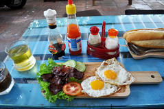 The whole shebang (Roving I) Tags: baconandeggs breadrolls breakfast woodenplates cafes cucumbers cyclo cutlery food friedeggs sauces danang dining condiments drinks tomatoes vietnam ilobsterit