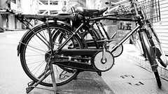 Delivery bikes in monochrome (Eric Flexyourhead) Tags: tsukiji  chuo chuoku  tokyo  japan  city urban street detail fragment bike bicycle jitensha  charinko  japanese sekine frame sign rust rusty rusting decay monochrome blackwhite bw shallowdepthoffield 169 olympusem5 panasoniclumix20mmf17