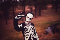 Bones (Adriana Gomez (Adriana Varela)) Tags: boy child childhood skeleton availablestockimage costume bones peace outdoors halloween holiday boyhood forest creek fall autumn