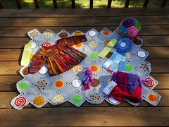 My 2016 North Carolina State Fair pieces return to the back deck (crochetbug13) Tags: crochet crocheted crocheting grannysquare squares purse tote diy babysweater sweater dodecahedron jellyfish veganmink vinx cookiebabyblanket cookie blanket