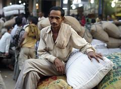 Spice market trader portrait (Mike Kruft) Tags: portrait india delhi worker resting spicemarket spicesack