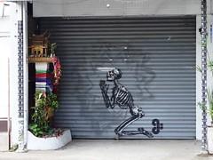 Thailand - Chiang Mai supplicant (ashabot) Tags: streetart thailand graffiti mementomori chiangmai streetscenes memorials alters skeltons