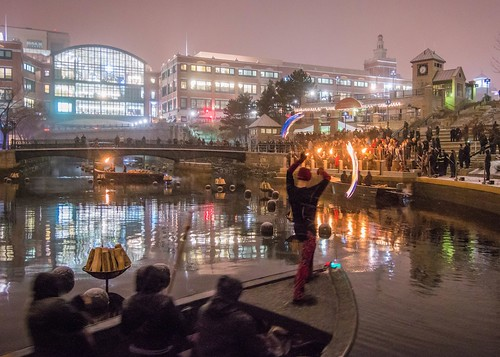Andrew Lindsay spins fire during the WaterFire Lighting Ceremony. Photo by Jennifer Bedford.