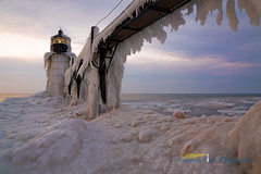Watercolor Sunset (Northern Light Photography by Robert Byrne) Tags: winter lighthouse snow ice frozen michigan stjoseph lakemichigan icicle stjosephlight stjosephlighthouse watercolorsunset puremichigan