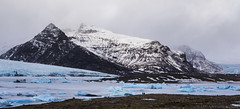 standing in the presence of nature's magnificence (lunaryuna) Tags: winter panorama snow mountains ice season landscape iceland glacier icefloes lunaryuna babyblue glacialice glaciertongue vatnajoekullnationalpark thecoloursoficeland joekullsarlonglacirlake