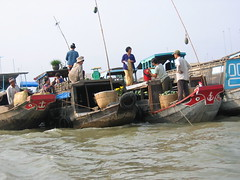 Selling Goods in Floating Market in Cai Be Vietnam