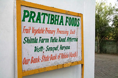 Sign For Pratibha Foods Processing Plant (IFPRI-IMAGES) Tags: india plant fruit foods corn village farm small farming grain cereal grow vegetable health farms produce farmer agriculture yield process processed development maize cannery cultivation agricultural sustainable pulses nutrition southasia massproduction manoli haryana shuck patiala farmtotable pratibha sonipat smallfarms foodsecurity agriculturaldevelopment foodprocessingplant farmtofork micronutrients kundli ifpri csisa shimlafarm pratibhafoods