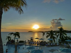 The pool and the ocean (Igor Sorokin) Tags: stthomas us usa virginislands island travel sunset ocean pool hotel resort people palm trees panasonic dmc pointandshoot