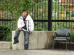 Waiting for Trouble (knightbefore_99) Tags: candid people corner thedrive commercialdrive vancouver eastvan staugustine west coast dude native first nation indian sit bc canada trouble