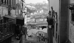 #031 (Matthew Hopper) Tags: canon blackandwhite bw portugal porto 2014 35mmfilm street clothes port river people alleyway alley porthouse summer wine graffiti drying clothesdrying calem