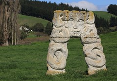 Contemporary Maori Carved Stone Sculpture Gentle Annie Napier - Taihape Road New Zealand (eriagn) Tags: newzealand northisland gentleannie napiertaihaperoad napier taihape maori stone carving taniwha contemporary handcarved rock lichen face paddock field farm farmhouse grass spiral patterns texture ngairehart eriagn ngairelawson photography rural countryside outdoor facial moko curvilinear eyes tongue stylised koru mori maoriart symbolism strength peace newlife growth silverfernfrond sculpture guardian unique