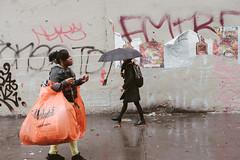 Woman carrying big orange bags in Chinatown (L. A. Nolan) Tags: 35mm 35mmf2 50mmequiv bags day fuji fujifilm fujifilmxpro2 fujinon fujinonxf35mmf2 manhattan newyork newyorkcity newyorknewyork ny nyc outdoors outside people streetphotography thebigapple twobridgesumbrella xpro2