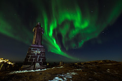 Northern Light and Hans Egede (bredsig) Tags: nuuk kitaa greenland gl auroraborealis hansegede northenlight northen light lights green spiral dark night nighttime statue sky polar arctic cold winter snow