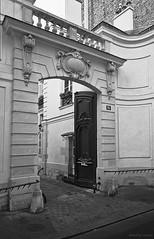 Ajar refinement (Antoine - Bkk) Tags: paris door heritage darktable black white architecture detail street