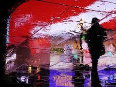 Circus Ghosts XXII (Douguerreotype) Tags: umbrella urbex street red lights city night tourism rain uk british england silhouette gb britain reflection piccadillycircus london upsidedown urban water people light