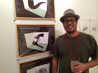 Artist David Palacios from Colombia  with his artwork at Pinta
