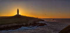 Contraluz en la Torre. (Emilio Rodrguez lvarez) Tags: ocean sunset sea sky panorama espaa sun color tower sol water backlight sunrise canon contraluz atardecer iso100 mar spain agua corua meer torre sonnenuntergang himmel panoramic calm galicia amanecer cielo panoramica 7d colored sonne weite f8 calma ocaso hercules vastness oceano hrcules  inmensidad ruhe farbige meerwasser  panoramisch hintergrundbeleuchtung eos7d tamron50mm herkulesturm 1800seg