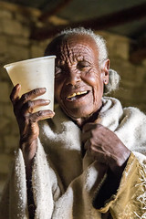 My bartender (Hulivili) Tags: africa old light portrait people woman church beer rock natural traditional north churches east ethiopia northern region tella hewn tigray