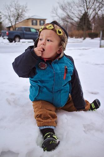 Snow eating toddler