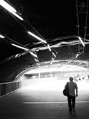There is a light that never goes out (marktmcn) Tags: darkened underpass light end tunnel flourescent lights lighting brick arch man walking away towards blackandwhite monochrome powershot sx210