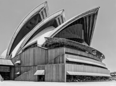 Opera Theatre Mono (f0rbe5) Tags: sydneyoperahouse soh operatheatre jrnutzon utzon architect architecture modernarchitecture engineering constructiontechnology construction technology creativegenius genius pritzkerprize contractors complexengineering complex problems costs geometry sphere prefabricated components prefabricatedcomponents structure building unesco worldheritagesite whs chevronpattern chevron pattern hgansab tiles sails shells precast concrete precastconcrete panels ribs glasscurtainwalls glasscurtain walls glass exterior pinkgranite tarana blackandwhite bw monochrome bennelongpoint sydneyharbour harbour sydney newsouthwales nsw australia australian iconic 2009