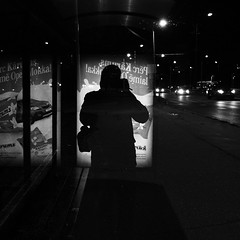 Waiting for the late bus (mkorolkov) Tags: street streetphotography bus busstop dark reflection selfie selfportrait night lights monochrome blackandwhite fujifilm xe1 xf1855mm xf1855mmf284