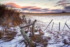 Follow the fence (John Andersen (JPAndersen images)) Tags: ranch clouds fence farm alberta hff