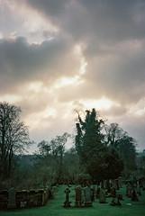 0084_20 (www.cjo.info) Tags: sunset sky cloud plant tree film cemetery 35mm scotland flora edinburgh kodak unitedkingdom rangefinder olympus analogue olympusxa roslin rosslynchapel kodakportra160 compactrangefinder geocity gravegraveyard exif:make=fujiphotofilmcoltd collegiatechurchofstmatthew camera:make=fujiphotofilmcoltd geostate geocountrys camera:model=sp3000 exif:model=sp3000 geo:lat=55855405555555 geo:lon=31602472222217