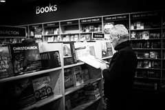 Must be an very interesting book (rick0530) Tags: street newzealand blackandwhite bw 35mm blackwhite bokeh f14 streetphotography auckland summilux asph m240 leica35mmsummiluxf14asph leicam240 type240 rick0530 streetsinauckland rick0530com