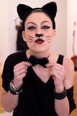 Pussycat #3 (Dolkin) Tags: carnival black cat costume bowtie noflash indoors pussycat pinkish facepaintmakeup cutegirlcutegirl catearswhiskers
