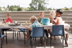 (nzfisher) Tags: boy newzealand party boys childhood feast canon children 50mm child eating deck eat auckland boyhood