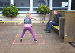 Hopscotch (KiwiMiriam) Tags: hopscotch school girl man jumping fuji xe2 23mm mirrorless
