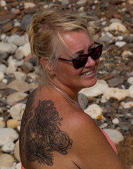 A back tattoo. (CWhatPhotos) Tags: beach shades smile smiles women female flowers upper back tattoo tattoos tattooed tatts inked ink blue foto pictures picture photos photo fotos image images that have which contain cwhatphotos photographs photograph art artwork artistic bare skin portraits portraited milf