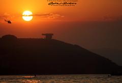 Atardecer en Gijn (omar suarez asturias) Tags: ocean red summer espaa canon contraluz atardecer mar spain asturias verano turismo cimadevilla gijon chillida oceano asturiasparaisonatural 150600mm