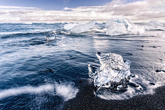 Jkulsrln magic (Anthony Gehin) Tags: blue light sea cloud black ice beach river landscape iceland sand magic wave lagoon vatnajokull glacial