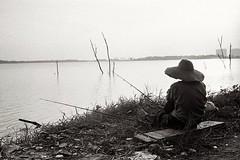 Fishing. (mshazwanzakarya) Tags: olympus olympus35sp 35sp 35mm film kodak trix lake fishing blackandwhite malaysia rangefinder