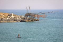 il trabocco (ROSSANA76 Getty Images Contributor) Tags: costa relax donna mare estate acqua pesca puglia vieste sud adriatico storia gargano peschici trabucco meridione