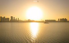 Great Ball of Fire (Andy Brandl (PhotonMix.com)) Tags: china sky misty river construction ship skyscrapers stadium nopeople hangzhou highrises zhejiang noclouds bigsun qiantangjiang photonmix