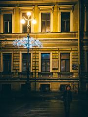 (miemo) Tags: street travel windows winter woman building night facade stpetersburg person hoodie streetlight europe crossing exterior russia olympus omd em5 panasonic1235mmf28