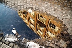 Break on Through (To the Other Side) (damar47) Tags: street city urban snow reflection building water puddle mirror pentax balcony ground bologna riflessi citycentre specchio balcone riflesso likeamirror viazamboni pentaxk30