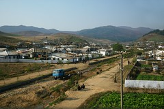 Village near Rajin (Rason) (Frhtau) Tags: dprk north korea korean people leute scene daily life asia asian east nordkorea scenery   choxin  outdoor      core du nord coreia do coria    culture landstrase landschaft wasser bach wasserlauf hgel flussbett fluss abhang feld gra