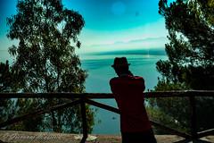 Looking at a beautiful panorama (giovyskia) Tags: panorama looking sea sky mountains landscape nature naturephotography human holiday happydays sicily italy sanvitolocapo trapani blue tree green foschia midday